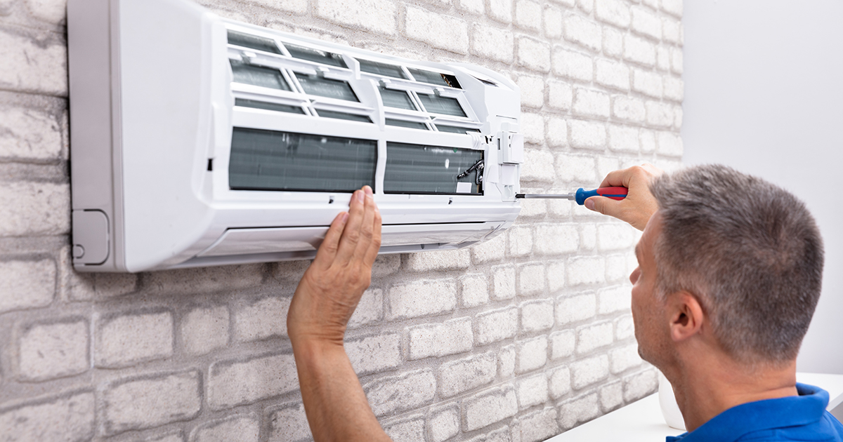 Service Technician Repairing Air Conditioning System in Southern NH or Maine