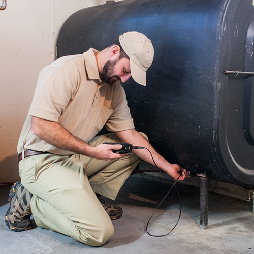 Technician Performing Oil Tank Testing by Estes Oil Company in Southern NH and Maine